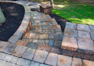 travertine pavers installed in a garden at sunshine coast pavers
